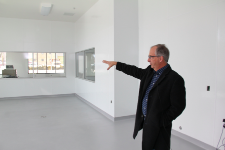 Robert Wills shows the room where cheese-making will take place, which is visible from the street through a plate-glass window. (Photo by Karen Slattery)